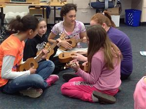 Students playing ukeleles in class.