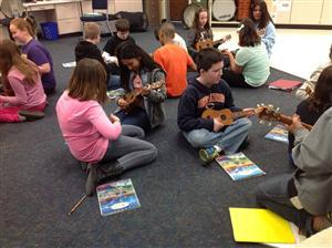 Additional students playing ukeleles in class.
